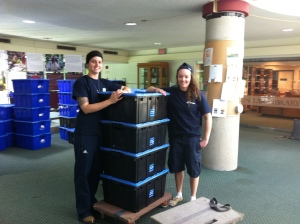 Cass and Tricia, working hard hauling those boxes. they make a great team