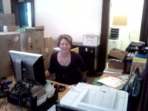 Acquisitions Coordinator Liz, already at work.  Lots of unpacking ahead of her